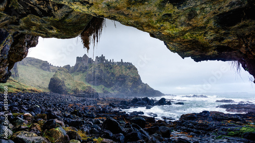 Ruined medieval Dunluce Castle on the cliff Canvas Print