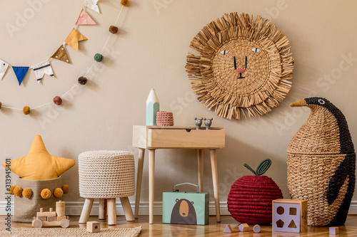 Photo Stylish scandinavian interior of child room with natural toys, hanging decoration, design furniture, plush animals, teddy bears and accessories