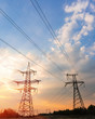High-voltage power lines at sunset or sunrise. High voltage electric transmission tower