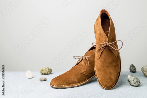 Obraz Fashion - men's camel suede desert shoes (boots) on grey - fototapety do salonu