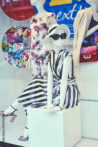 Boutique window with dressed mannequins Canvas Print