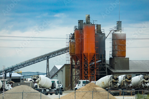 A wide angle view of a concrete batching and manufacture plant with aggregate co Wallpaper Mural