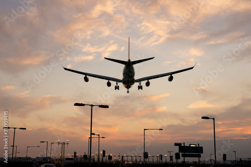 Airplane approaching Heathrow at sunset Canvas Print