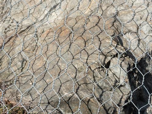 Fototapeta metal mesh  protects mountain roads from landslide and rockfall