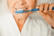 Old Woman Brushing Teeth In Th...