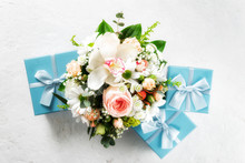 Flower Bouquet With Blue Gift Boxes On White Background Flat Lay Top View