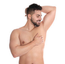 Young Man Showing Hairless Armpit After Epilation Procedure On White Background