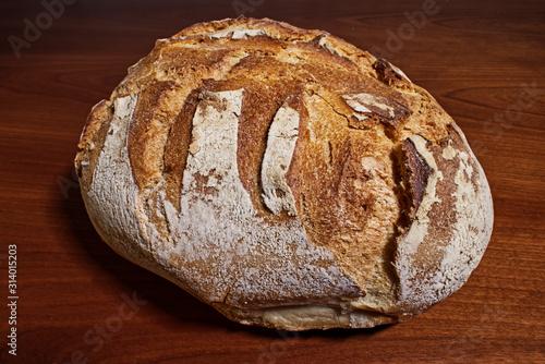 Fresh loaf of Apulian bread on wooden table Wallpaper Mural