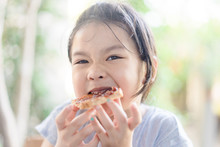 Funny Little Asian Girl Eating...