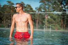 Cheerful Young Man Relaxing In Swimming Pool