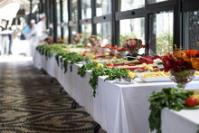 Table With Breakfast In Garden...