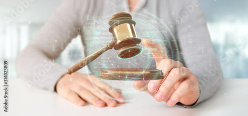 Obraz Businessman holding a Justice hammer and data - 3d rendering - fototapety do salonu