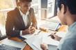 Leinwanddruck Bild - Loan business finance businessman explain business report from data analysis or bank marketing for loan money. Selected focus.