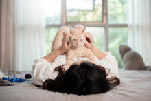 Beautiful Asian  Cat Lover Woman Is Playing With Cat In Her Room