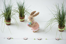 Easter Bunny With Decorations. Easter Eggs, Grass, Tulips.