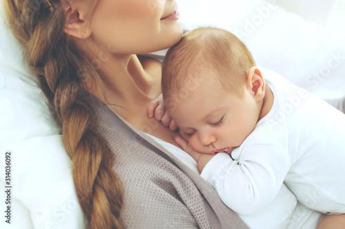 Obraz Woman with a baby. - fototapety do salonu