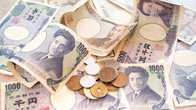 Japanese Yen Banknotes And Japanese Yen Coins For Background Image, Vintage Tone Concept