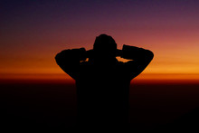 Silhouette Of A Man At Sunset