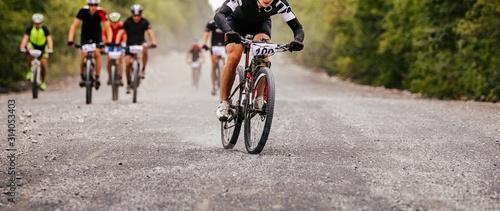 cyclist rider at head of peloton cross-country mountain bike race Wallpaper Mural