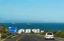 Mossel Bay, Western Cape, South Africa. December 2019. The N2 Highway Approaching Mussel Bay And The Indian Ocean. Exit Sign For Hartenbos.