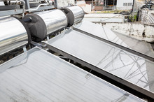 Solar Water Heater On A Roof