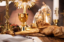 Catholic Concept Background.  The Cross, Monstrance, Jesus Figure, Holy Bible And Golden Chalice On The Rustic Wooden Table.