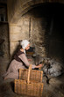 Leinwanddruck Bild - Rembrandt portrait of woman at fireplace