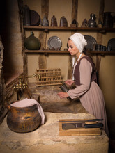 Woman In Antique Kitchen