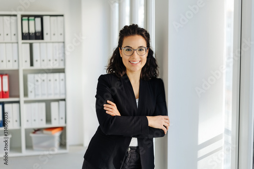 Obraz Happy relaxed young professional woman - fototapety do salonu