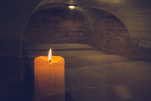 A Candle In A Dark Old Burial ...