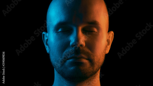 A man with closed eyes is meditating. Dual color theme. Black background