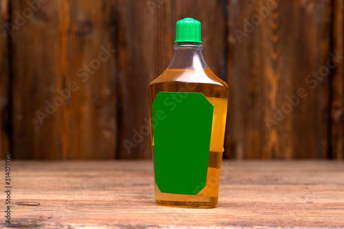aftershave glass bottle on wooden background, close-view Canvas Print