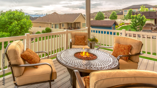 Pano frame Chairs around table with fire pit at a residential balcony framed wit Canvas Print