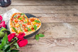 canvas print picture - Pizza for Valentine day. Heart shaped homemade pizza margarita. Valentines day romantic menu concept. With wine bottle, roses flowers and and wineglass. Wooden background copy space