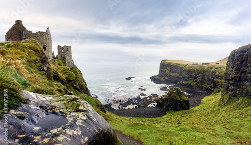 Ruined medieval Dunluce Castle on the cliff dramatic sky Canvas Print
