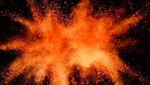 Explosion Of Orange Powder Isolated On Black Background