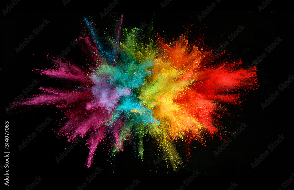 Fototapeta Explosion of colored powder isolated on black background