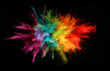 Explosion of colored powder isolated on black background