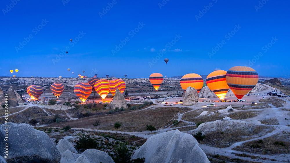 Fototapeta Vibrant colorful hot air balloons in Cappadocia, Turkey.