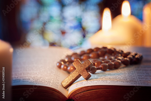 Fototapeta Rosary beads and crucifix cross on holy bible