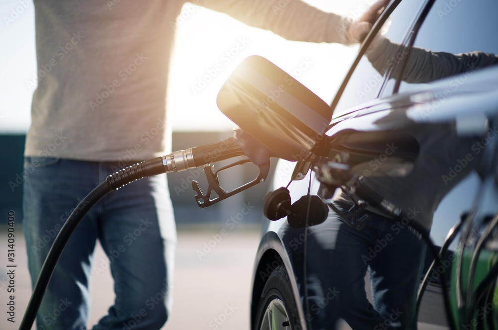 Fototapeta Men Refueling Modern Car