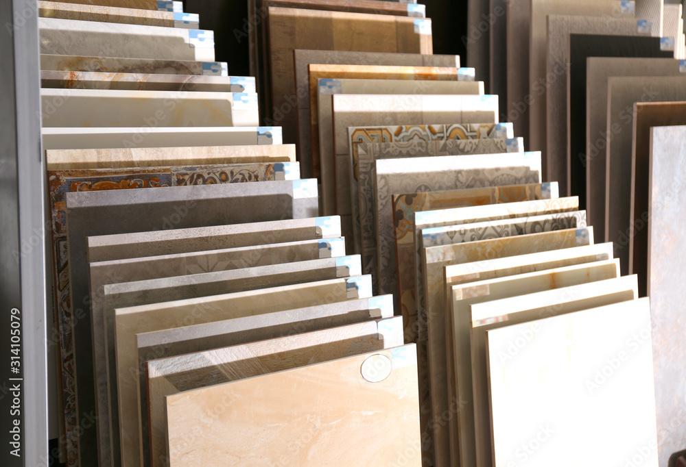 Fototapeta Various ceramic tile samples in store. Total wholesale