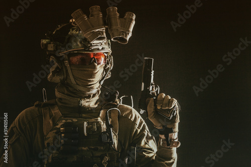 Fényképezés Side view portrait of army soldier, modern combatant, special forces fighter in