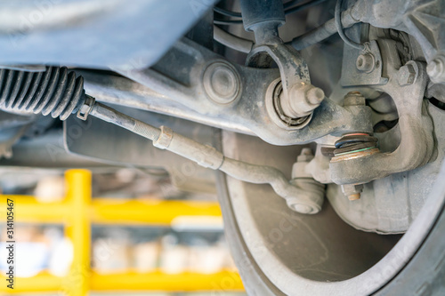 Obraz na plátně car bottom view for ball joint and control arm power steering rack suspension sy