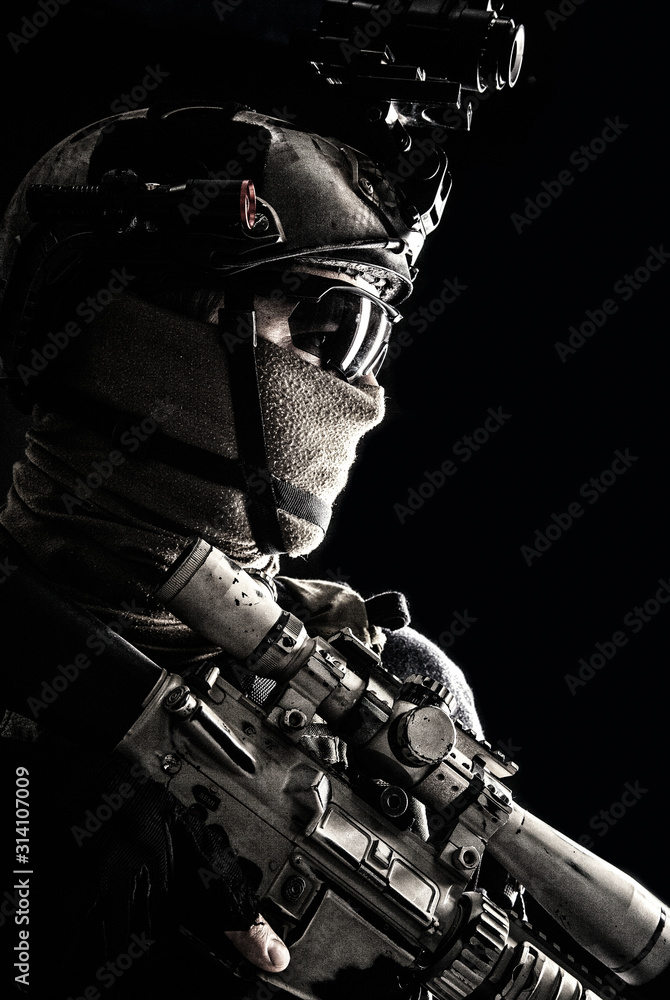 Fototapeta Shoulder portrait of army elite troops sniper, anti-terrorist tactical team marksman wearing helmet with thermal imager, hiding face behind mask, armed rifle with optical scope, studio shoot on black