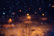 falling snow at night with bokeh effect