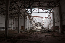 An Abandoned Hangar With A Rui...