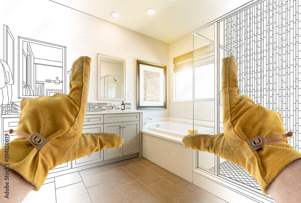 Fototapeta Male Contractor Hands Framing Completed Section of Bathroom Over Bathroom Drawing