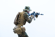 Soldier In Action Aiming Lasee...
