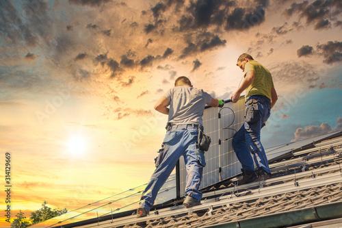 Fotografie, Obraz Installing solar photovoltaic panel system